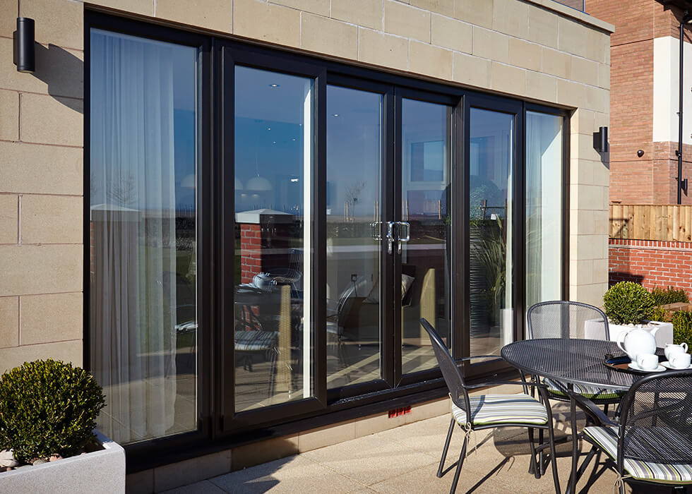 https://stedek.co.uk/wp-content/uploads/2018/04/Patio-Master-black-sliding-door.jpg