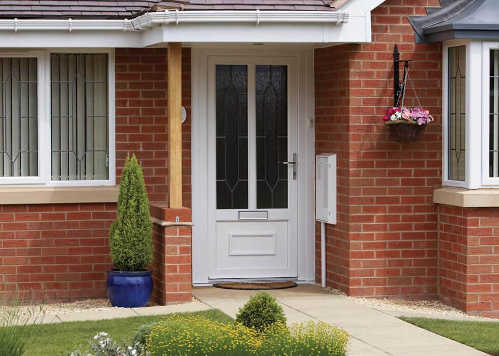 https://stedek.co.uk/wp-content/uploads/2018/04/uPVC-entrance-door-with-silver-hardware.jpg