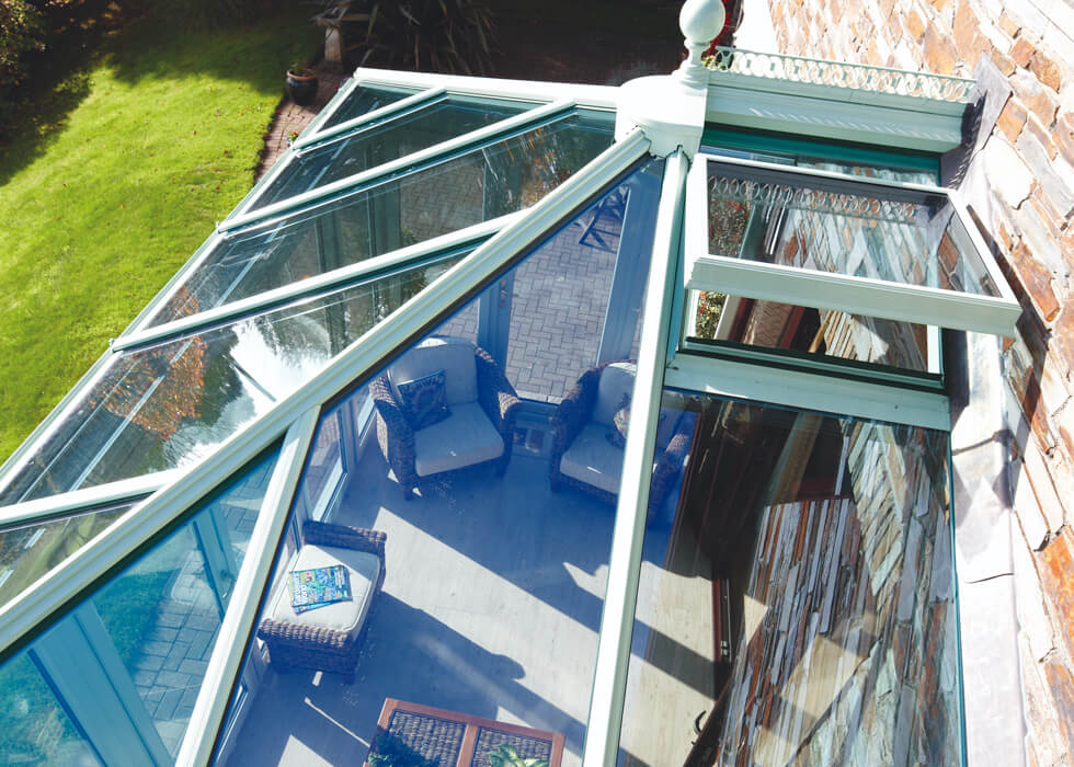 https://stedek.co.uk/wp-content/uploads/2018/06/Glass-conservatory-roof-chartwell-green.jpg